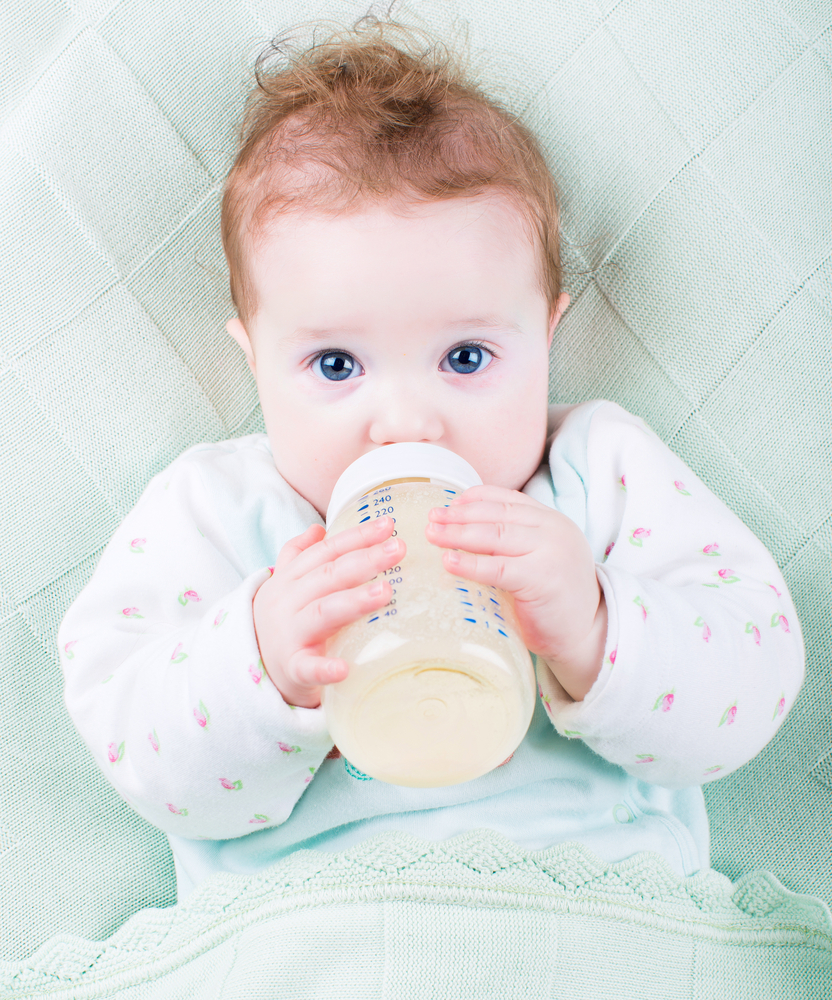 baby drinking formula from a bottle