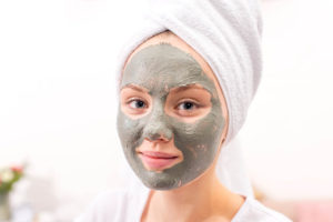 clay face mask on woman